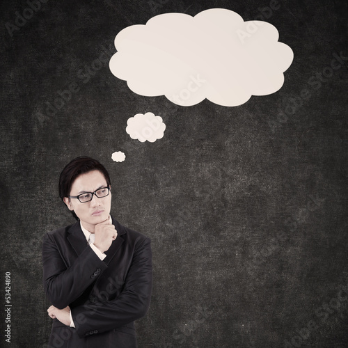 Thoughtful Asian Businessman shot in studio