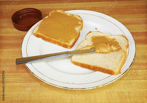 Spreading Peanut Butter on a Slice of Bread