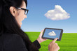 Businesswoman and touch pad, cloud computing concept