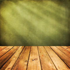 Wooden deck floor over green grunge background