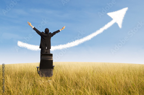 Happy businessman and growing chart cloud outdoor