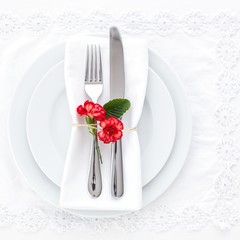 Place setting decorated with carnations