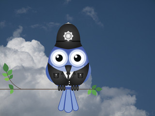 Comical bird policeman sat on a branch