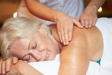 Senior Woman Having Massage In Spa