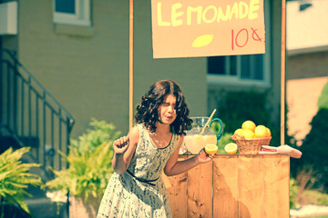 retro girl making funny face holding a lemon