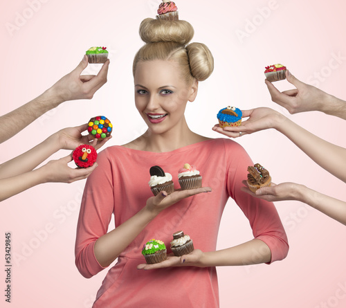 pretty girl with many colorful cupcakes