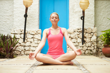Woman Meditating Outdoors At Health Spa