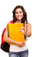 Young happy student doing Ok Sign