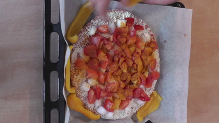The making of pizza, hand made at home.