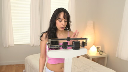 Young woman checks scale