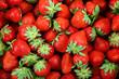 Fresh strawberry fruit as a backdrop.