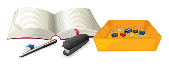 A notebook and the different school supplies