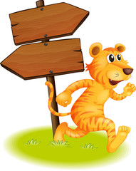 A tiger running and the empty signboards