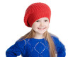 little girl in a red cap smiles, isolation on white