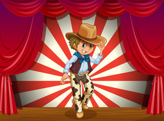 A cowboy in the middle of the stage