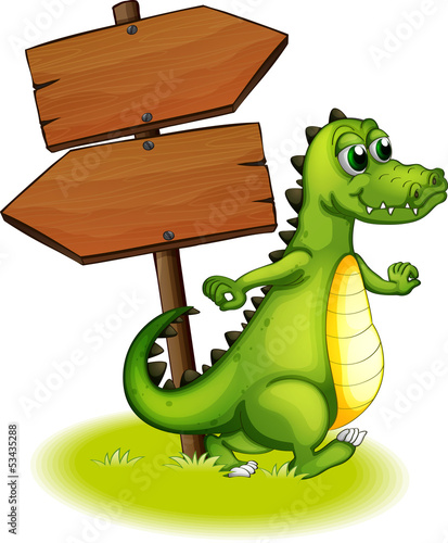 A crocodile beside the wooden empty arrowboard