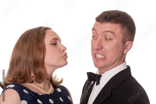 Man does not want kiss from woman - isolated on white