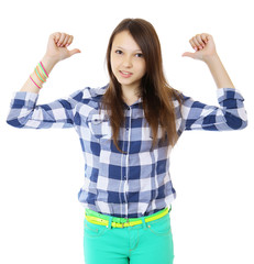 Young teen girl pointing behind with her thumb. Young woman