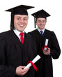 Two male graduates with scrolls, isolated on white