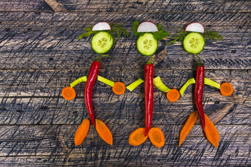 family people vegetable holding hands wooden carrots cucumber le