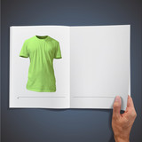 Empty green shirt inside a book.