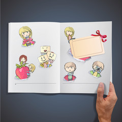 Set of kids in hole paper inside a book.
