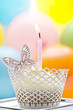 Birthday cupcake with candle and butterfly
