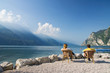 man and woman sitting at the lake garda, italien