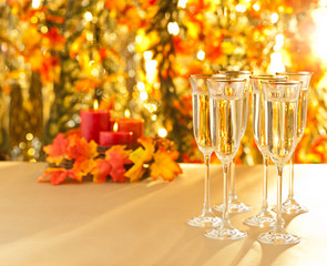 Champagne glasses for reception in front of autumn background
