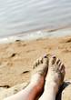 Feet in sand on the beach