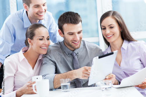 Coworkers looking at digital tablet