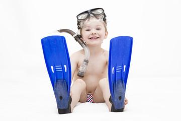 Kind mit Taucherausrüstung