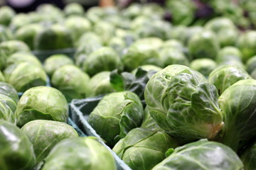 Cartons of fresh brussel sprouts at the market