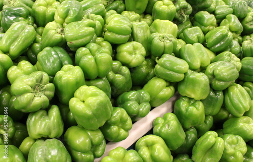 Bins of fresh sweet green peppers at the market