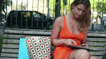 Woman online shopping with tablet computer, steadicam shot