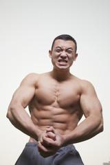 Muscular Man Growling and Flexing Shirtless