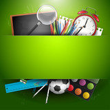 Fototapety School supplies on green background with place for text