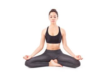 beautiful young woman making a Yoga pose