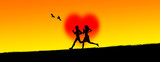 Silhouette of a young loving couple jogging