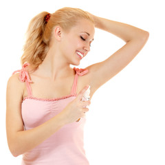 young woman putting deoporant on her armpit