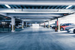 Parking garage, interior with a few parked cars. - 53448295