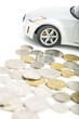 Coins on white with car