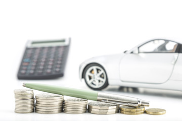 Coins with car, pen and calculator
