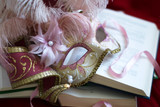 Italian carnival mask and books
