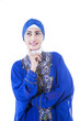 Beautiful female muslim in blue dress - isolated