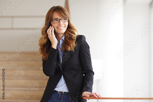 Lawyer Standing in Courthouse and Using her Mobile Phone