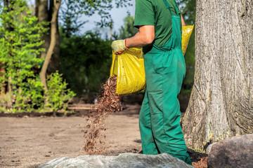 Gardener spills garden bark