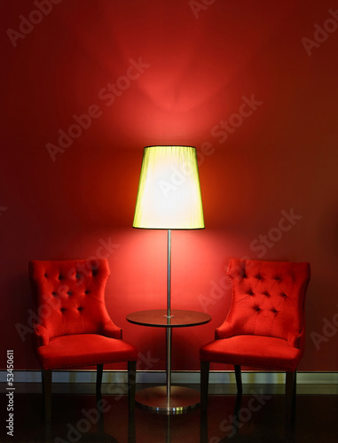 Red luxury chairs with table and lamp