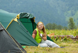 Happy  hiker in front of camp tent