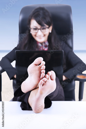 Happy businesswoman relax at beach